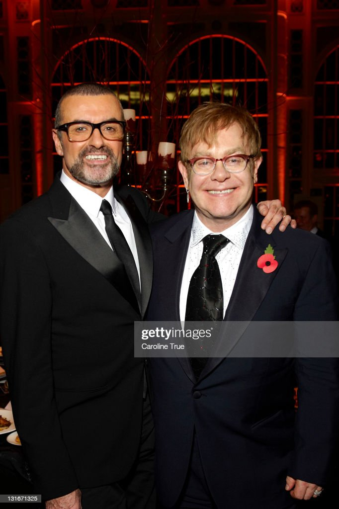 Musicians George Michael and Sir Elton John attend a charity performance benefiting the Elton John AIDS Foundation's newly created Elizabeth Taylor Memorial Fund at the Royal Opera House on November 6, 2011 in London, England.