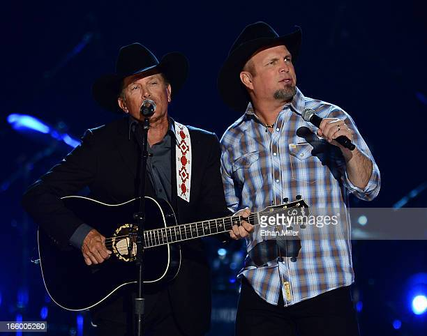 Musicians George Strait and Garth Brooks perform onstage during the 48th Annual Academy of Country Music Awards at the MGM Grand Garden Arena on...
