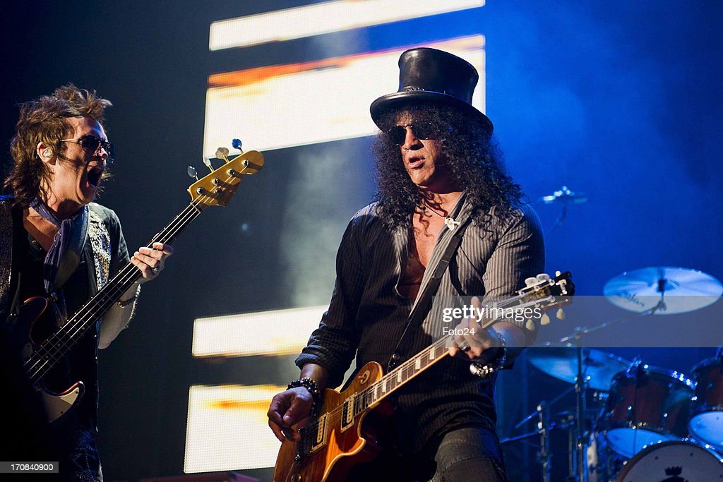 Musicians Glenn Hughes and Slash and Gilby Clarke during the Kings of Chaos concert on June 16, 2013 in Sun City, South Africa. Kings of Chaos performed in Sun City on June 15 and 16, 2013.
