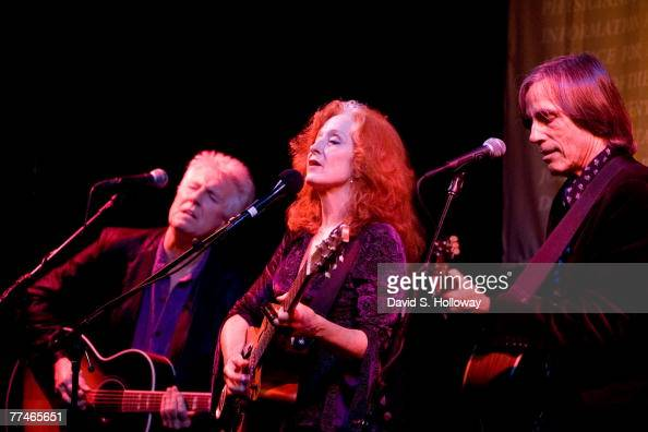 Musicians Graham Nash Bonnie Raitt and Jackson Browne perform in the Cannon House Office building to create awareness about a petition to Congress...