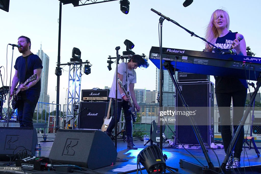 Musicians Gregori Chad Petree, Jeremy Dawson, and Carah Faye Charnow of Shiny Toy Guns perform in concert during the Keep Austin Weird Festival at The Long Center on June 22, 2013 in Austin, Texas.