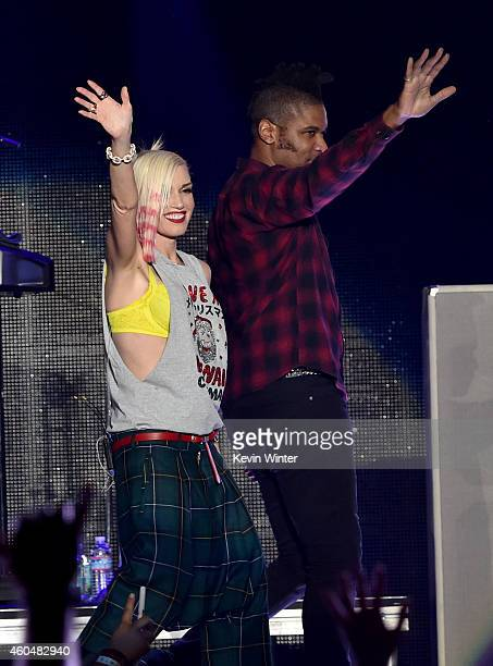 Musicians Gwen Stefani and Adrian Young of No Doubt perform onstage during day two of the 25th annual KROQ Almost Acoustic Christmas at The Forum on...