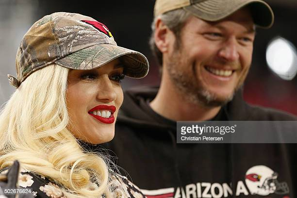 Musicians Gwen Stefani and Blake Shelton attend the NFL game between the Green Bay Packers and Arizona Cardinals at the University of Phoenix Stadium...