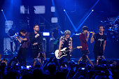 Musicians Harry Styles Liam Payne Niall Horan Zayn Malik and Louis Tomlinson of One Direction perform onstage during the 2014 iHeartRadio Music...