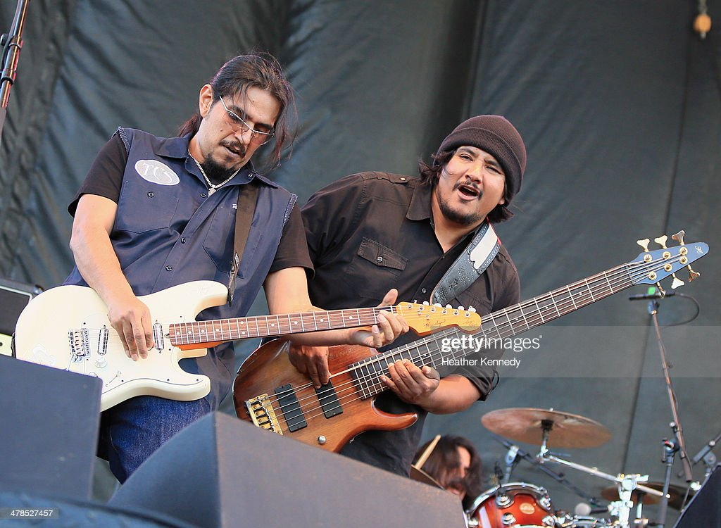 Musicians <a gi-track='captionPersonalityLinkClicked' href=/galleries/search?phrase=Henry+Garza&family=editorial&specificpeople=220941 ng-click='$event.stopPropagation()'>Henry Garza</a> and Jojo Garza of Los Lonely Boys perform onstage at the USPS Hendrix Stamp Event + Los Lonely Boys during the 2014 SXSW Music, Film + Interactive at Butler Park on March 13, 2014 in Austin, Texas.