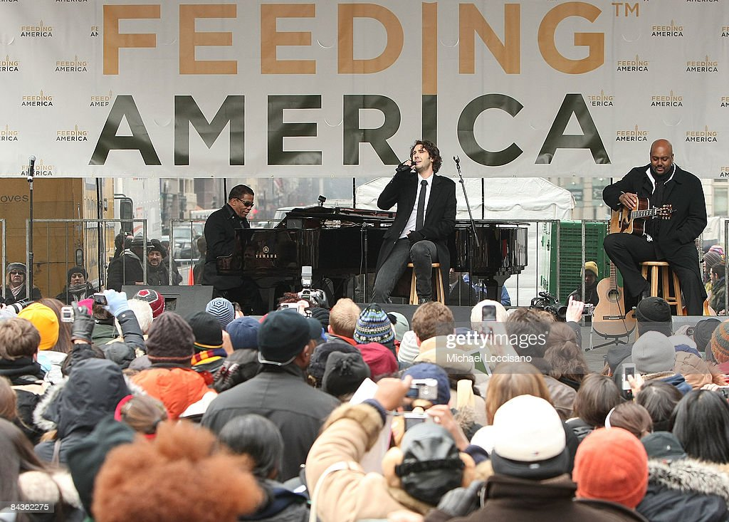 Musicians Herbie Hancock and Josh Groban perform together at the National Hunger Rally hosted by Feeding America at Martin Luther King Library on...