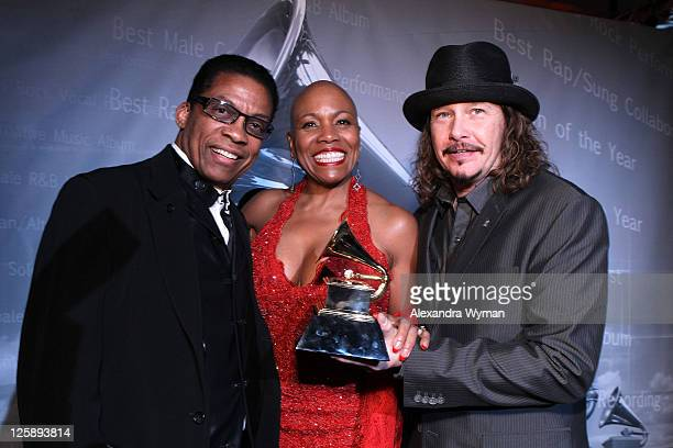 Musicians Herbie Hancock Dee Dee Bridgewater and Recording Academy Chair George Flanigen backstage during The 53rd Annual GRAMMY Awards PreTelecast...