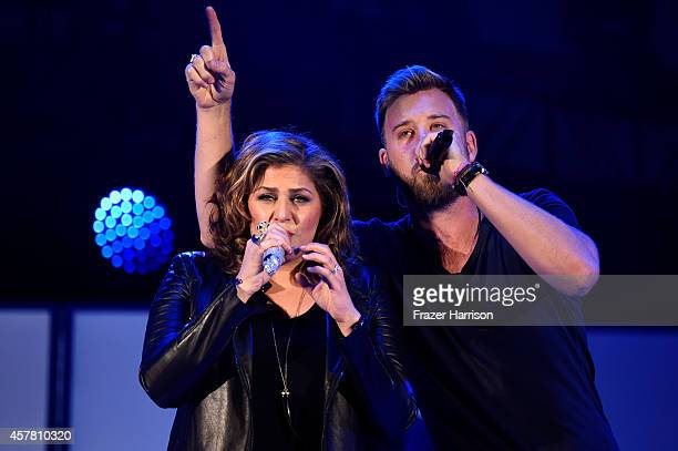 Musicians Hillary Scott and Charles Kelley of Lady Antebellum perform onstage during CBS Radio's We Can Survive at the Hollywood Bowl on October 24...
