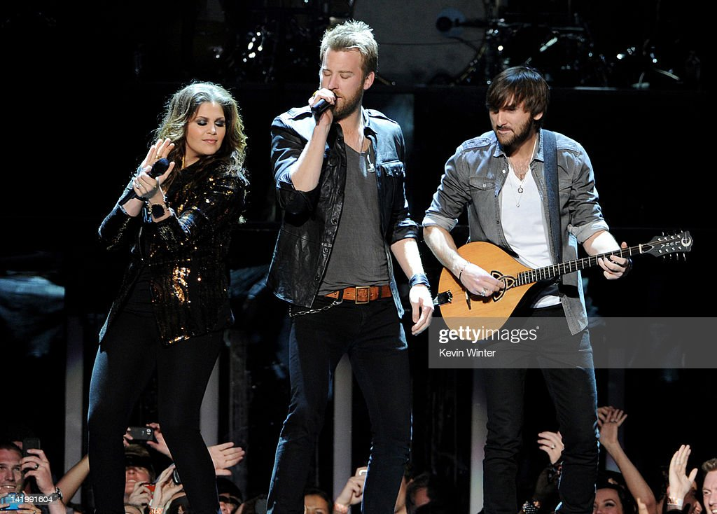 Musicians Hillary Scott, <a gi-track='captionPersonalityLinkClicked' href=/galleries/search?phrase=Charles+Kelley&family=editorial&specificpeople=3935435 ng-click='$event.stopPropagation()'>Charles Kelley</a> and <a gi-track='captionPersonalityLinkClicked' href=/galleries/search?phrase=Dave+Haywood&family=editorial&specificpeople=4620526 ng-click='$event.stopPropagation()'>Dave Haywood</a> of Lady Antebellum perform at Staples Center on March 27, 2012 in Los Angeles, California.