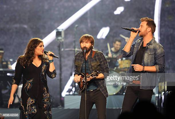 Musicians Hillary Scott Dave Haywood and Charles Kelley of Lady Antebellum perform at Sprint Center on February 15 2014 in Kansas City Missouri