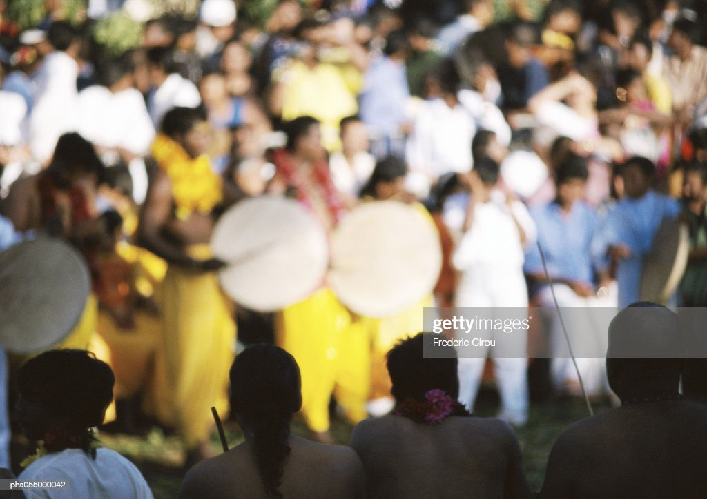 Musicians in a crowd, blurred : Stock Photo