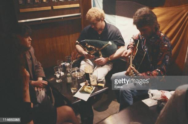 Musicians in a pub play traditional Irish music Ballinamore Ireland August 1992