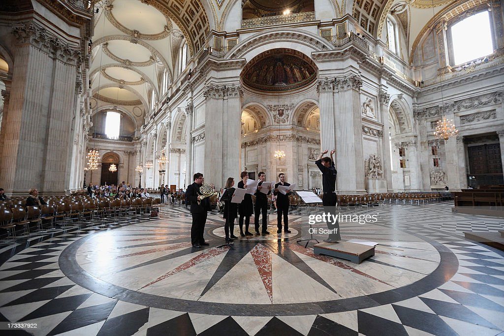 Musicians in St Paul's Cathedral perform the 8 minute piece 'Live Music Sculpture 3: St Paul's Cathedral' on July 12, 2013 in London, England. The work has been composed by Samuel Bordoli specifically for the Cathedral's acoustic properties and features 27 musicians in 6 groupings spread throughout the vertical and horizontal points of the building.