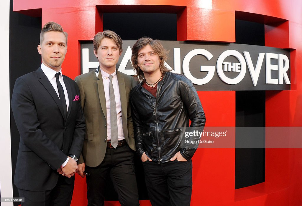 Musicians <a gi-track='captionPersonalityLinkClicked' href=/galleries/search?phrase=Isaac+Hanson&family=editorial&specificpeople=213257 ng-click='$event.stopPropagation()'>Isaac Hanson</a>, <a gi-track='captionPersonalityLinkClicked' href=/galleries/search?phrase=Taylor+Hanson&family=editorial&specificpeople=210666 ng-click='$event.stopPropagation()'>Taylor Hanson</a> and <a gi-track='captionPersonalityLinkClicked' href=/galleries/search?phrase=Zac+Hanson+-+M%C3%BAsico&family=editorial&specificpeople=206818 ng-click='$event.stopPropagation()'>Zac Hanson</a> of Hanson arrive at the Los Angeles premiere of 'The Hangover III' at Mann's Village Theatre on May 20, 2013 in Westwood, California.