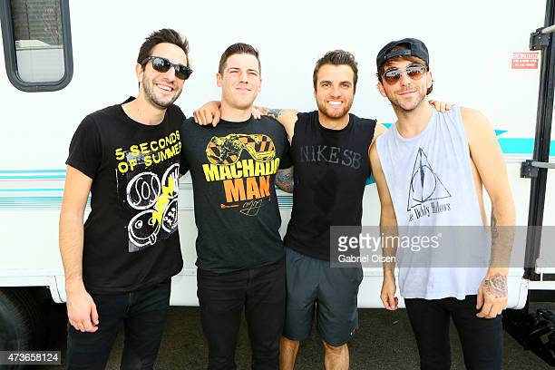 Musicians Jack Barakat Zack Merrick Rian Dawson and Alex Gaskarth of All Time Low pose backstage at the KROQ Weenie Roast Y Fiesta 2015 at Irvine...
