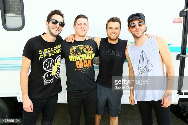 Musicians Jack Barakat Zack Merrick Rian Dawson and Alex Gaskarth of All Time Low pose backstage at the KROQ Weenie Roast Y Fiesta 2015 at Irvine...