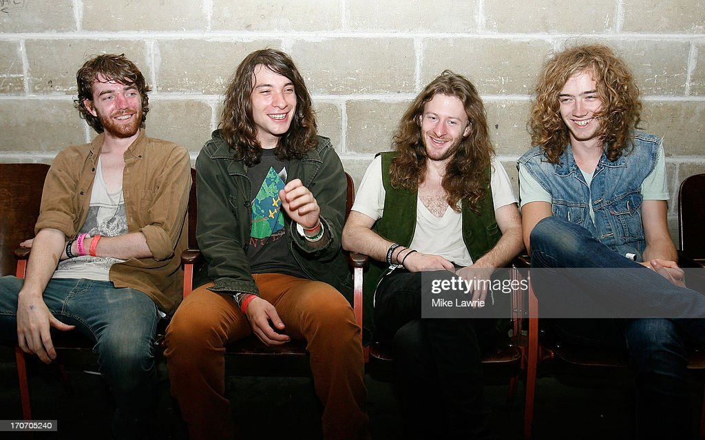 Musicians Jack Collins, Matt Stevenson, Ethan Snyder and Samuel Shea of Spires pose prior to performing during the 2013 Northside Festival at the Jameson Black Barrel Lounge at Villain on June 16, 2013 in the Brooklyn borough of New York City.