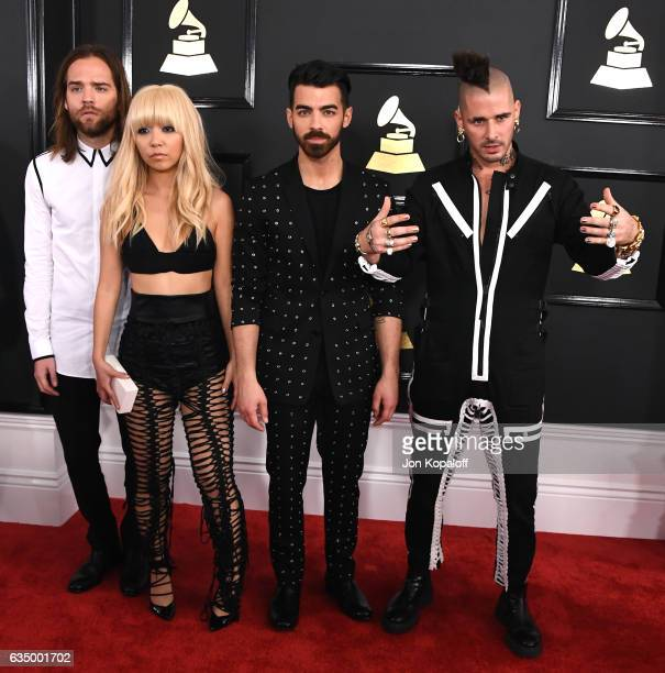 Musicians Jack Lawless JinJoo Lee Joe Jonas and Cole Whittle of DNCE attend The 59th GRAMMY Awards at STAPLES Center on February 12 2017 in Los...