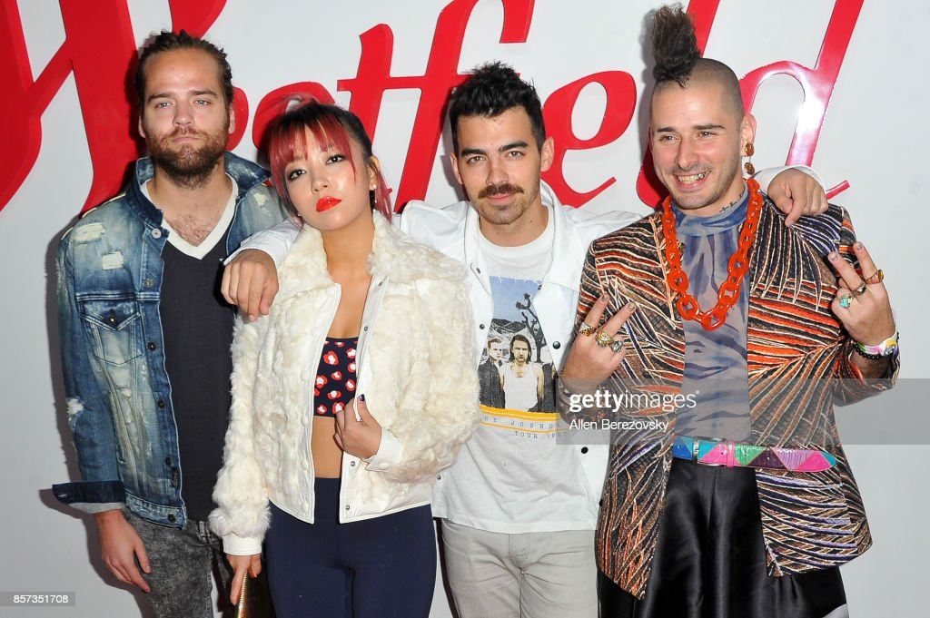 Musicians Jack Lawless, JinJoo Lee, Joe Jonas and Cole Whittle of DNCE attend the grand opening of Westfield Century City at Westfield Century City on October 3, 2017 in Century City, California.