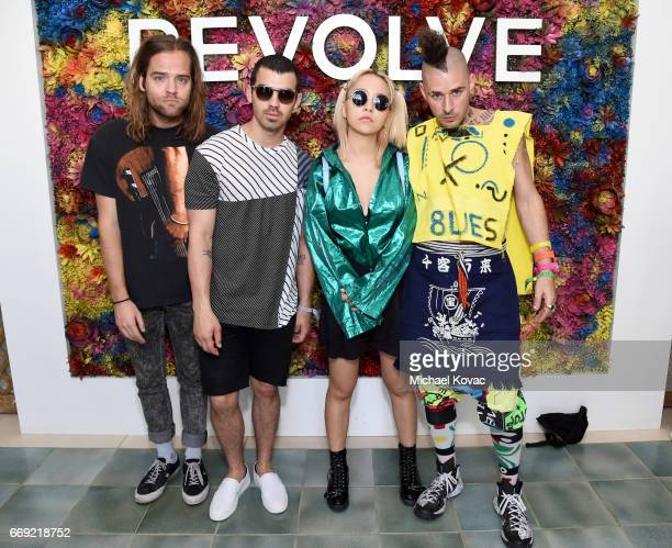 Musicians Jack Lawless Joe Jonas JinJoo Lee and Cole Whittle of DNCE attend the #REVOLVEfestival at Coachella with Moet Chandon on April 16 2017 in...