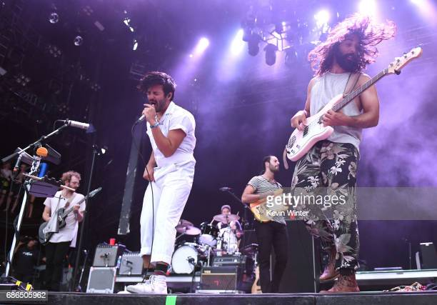 Musicians Jacob Tilley Sameer Gadhia Francois Comtois Eric Cannata and Payam Doostzadeh of the band Young the Giant perform at the Hangout Stage...