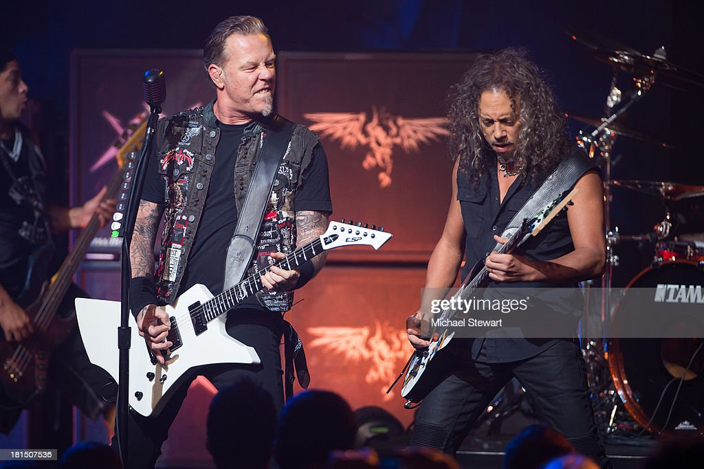 Musicians James Hetfield (L) and Kirk Hammett of Metallica perform at a private exclusive concert for SiriusXM listeners at The Apollo Theater on September 21, 2013 in New York City.