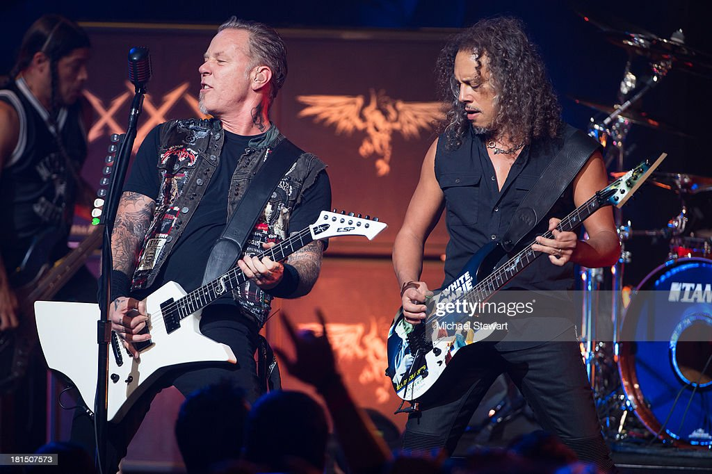 Musicians <a gi-track='captionPersonalityLinkClicked' href=/galleries/search?phrase=James+Hetfield&family=editorial&specificpeople=178297 ng-click='$event.stopPropagation()'>James Hetfield</a> (L) and <a gi-track='captionPersonalityLinkClicked' href=/galleries/search?phrase=Kirk+Hammett&family=editorial&specificpeople=204665 ng-click='$event.stopPropagation()'>Kirk Hammett</a> of Metallica perform at a private exclusive concert for SiriusXM listeners at The Apollo Theater on September 21, 2013 in New York City.