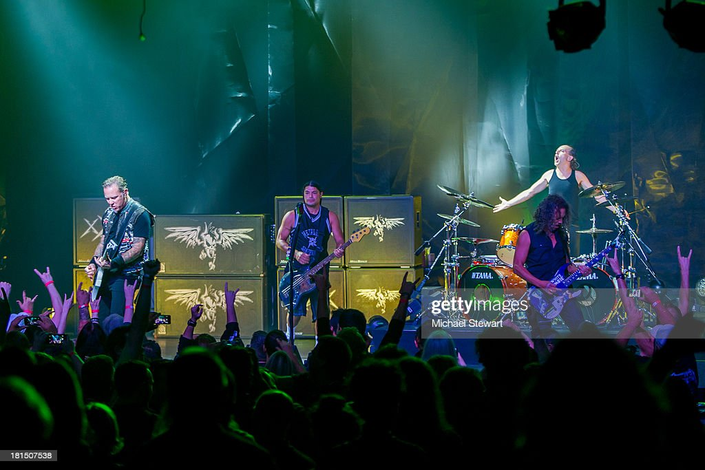 Musicians James Hetfield, Robert Trujillo, Kirk Hammett and Lars Ulrich of Metallica perform at a private exclusive concert for SiriusXM listeners at The Apollo Theater on September 21, 2013 in New York City.