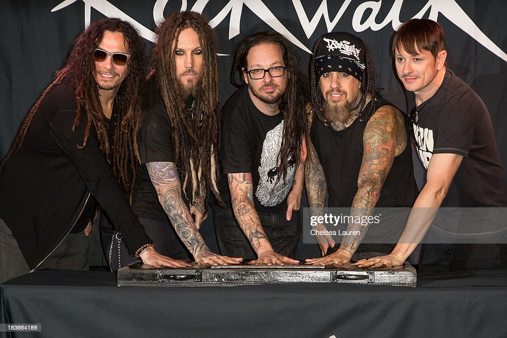 Musicians James 'Munky' Shaffer, Brian 'Head' Welch, <a gi-track='captionPersonalityLinkClicked' href=/galleries/search?phrase=Jonathan+Davis&family=editorial&specificpeople=221592 ng-click='$event.stopPropagation()'>Jonathan Davis</a>, Reginald '<a gi-track='captionPersonalityLinkClicked' href=/galleries/search?phrase=Fieldy&family=editorial&specificpeople=573012 ng-click='$event.stopPropagation()'>Fieldy</a>' Arvizu and Ray Luzier of KoRn are inducted into Guitar Center's RockWalk at Guitar Center on October 8, 2013 in Hollywood, California.