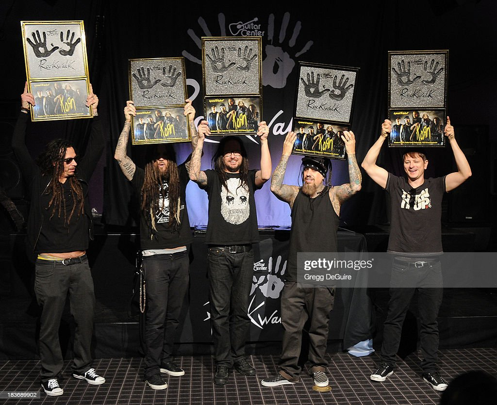 Musicians James 'Munky' Shaffer, Brian 'Head' Welch, Jonathan Davis, Reginald 'Fieldy' Arvizu and Ray Luzier of KORN attend their induction ceremony into Guitar Center's RockWalk at Guitar Center on October 8, 2013 in Hollywood, California.