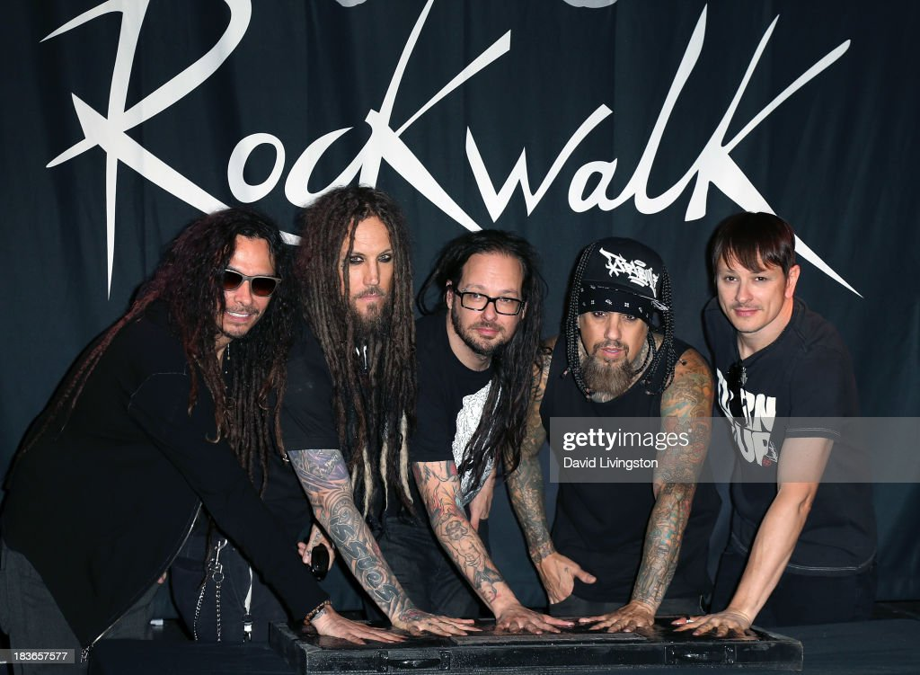 Musicians James 'Munky' Shaffer, <a gi-track='captionPersonalityLinkClicked' href=/galleries/search?phrase=Brian+Welch&family=editorial&specificpeople=3209697 ng-click='$event.stopPropagation()'>Brian Welch</a>, <a gi-track='captionPersonalityLinkClicked' href=/galleries/search?phrase=Jonathan+Davis&family=editorial&specificpeople=221592 ng-click='$event.stopPropagation()'>Jonathan Davis</a>, Reginald '<a gi-track='captionPersonalityLinkClicked' href=/galleries/search?phrase=Fieldy&family=editorial&specificpeople=573012 ng-click='$event.stopPropagation()'>Fieldy</a>' Arvizu and Ray Luzier of Korn attend Korn's induction into Guitar Center's RockWalk at Guitar Center on October 8, 2013 in Hollywood, California.