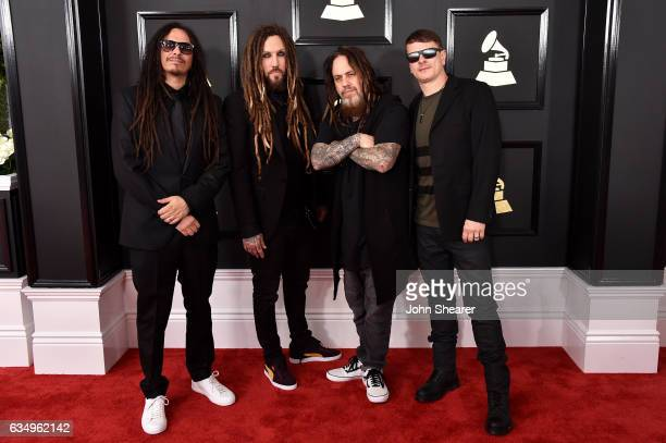 Musicians James Shaffer Brian Welch Reginald Arvizu and Ray Luzier of the music group Korn attend The 59th GRAMMY Awards at STAPLES Center on...