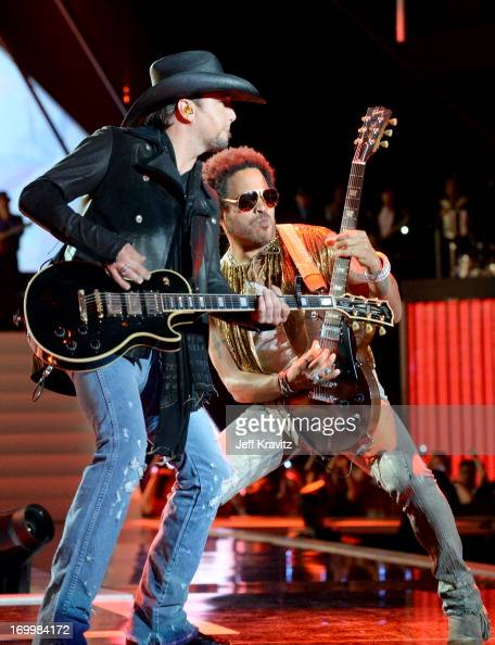 Musicians Jason Aldean and Lenny Kravitz perform onstage at the 2013 CMT Music Awards at the Bridgestone Arena on June 5 2013 in Nashville Tennessee