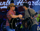 Musicians Jason Aldean and Luke Bryan perform onstage during the American Country Awards 2010 held at the MGM Grand Garden Arena on December 6 2010...