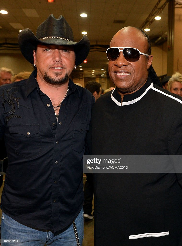 Musicians <a gi-track='captionPersonalityLinkClicked' href=/galleries/search?phrase=Jason+Aldean&family=editorial&specificpeople=619221 ng-click='$event.stopPropagation()'>Jason Aldean</a> and <a gi-track='captionPersonalityLinkClicked' href=/galleries/search?phrase=Stevie+Wonder&family=editorial&specificpeople=171911 ng-click='$event.stopPropagation()'>Stevie Wonder</a> attend the 48th Annual Academy of Country Music Awards at the MGM Grand Garden Arena on April 7, 2013 in Las Vegas, Nevada.