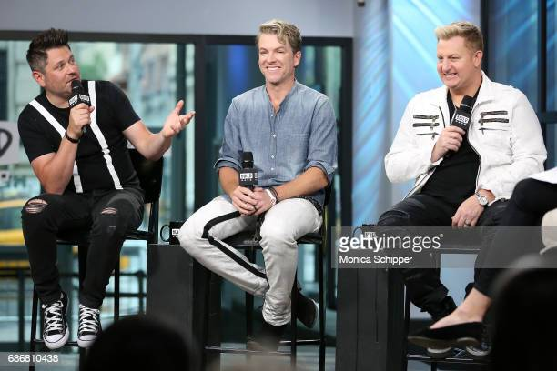 Musicians Jay DeMarcus Joe Don Rooney and Gary LeVox of band Rascal Flatts speak on stage at Build presents Rascal Flatts promoting their new album...