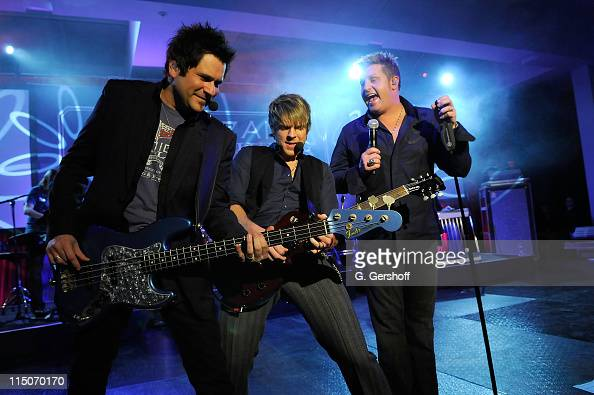 Musicians Jay DeMarcus Joe Don Rooney and Gary LeVox of Rascal Flatts perform live for the invited guests at JCPenney's American Living Launch Party...
