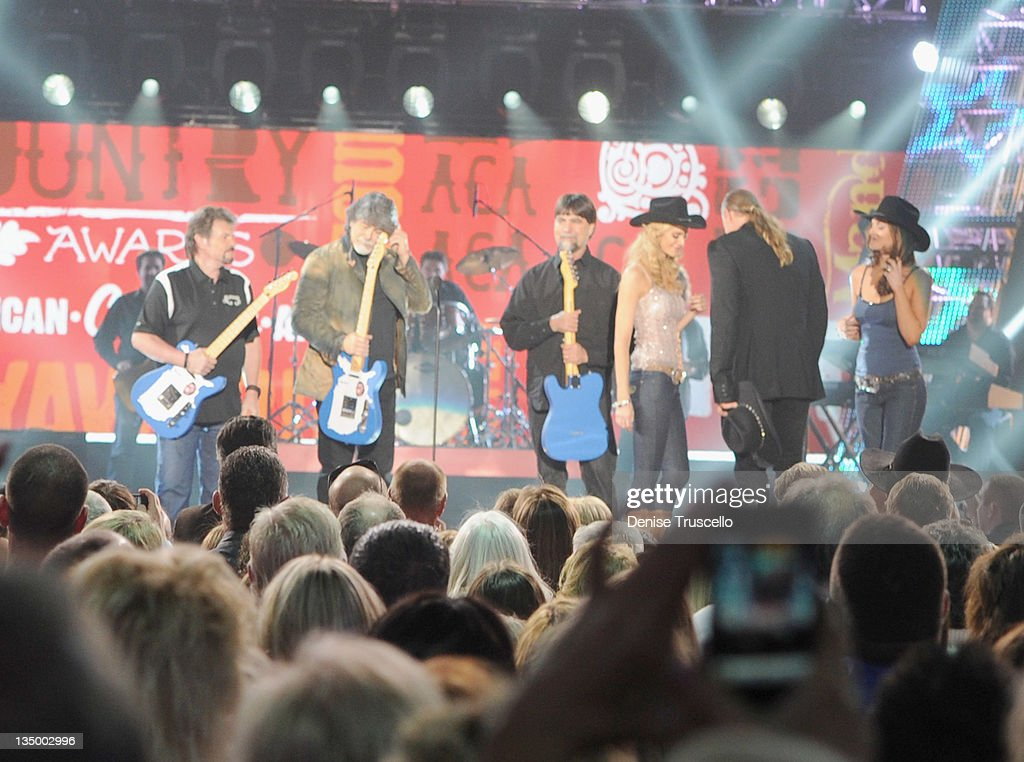 Musicians Jeff Cook, <a gi-track='captionPersonalityLinkClicked' href=/galleries/search?phrase=Randy+Owen&family=editorial&specificpeople=619729 ng-click='$event.stopPropagation()'>Randy Owen</a> and <a gi-track='captionPersonalityLinkClicked' href=/galleries/search?phrase=Teddy+Gentry&family=editorial&specificpeople=1063885 ng-click='$event.stopPropagation()'>Teddy Gentry</a> of the music group Alabama accept the award for Greatest Hits from presenter <a gi-track='captionPersonalityLinkClicked' href=/galleries/search?phrase=Trace+Adkins&family=editorial&specificpeople=224686 ng-click='$event.stopPropagation()'>Trace Adkins</a> onstage during the 2011 American Country Awards at MGM Grand Garden Arena on December 5, 2011 in Las Vegas, Nevada.