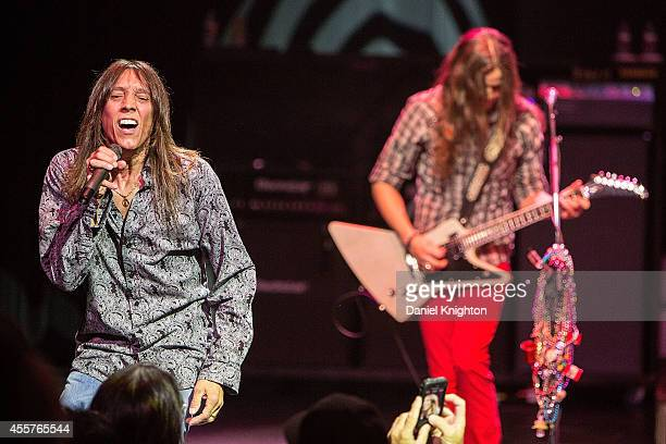 Musicians Jeff Keith and Dave Rude perform on stage with Tesla on September 19 2014 in El Cajon California