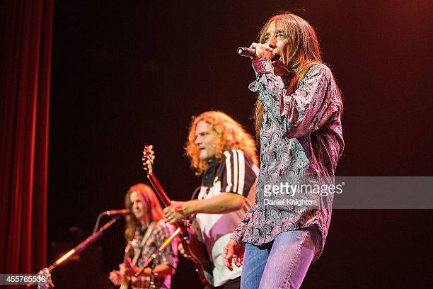 Musicians Jeff Keith Frank Hannon and Dave Rude perform on stage with Tesla on September 19 2014 in El Cajon California