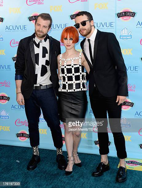 Musicians Jeremy Davis Hayley Williams and Taylor York of Paramore attend the Teen Choice Awards 2013 at Gibson Amphitheatre on August 11 2013 in...