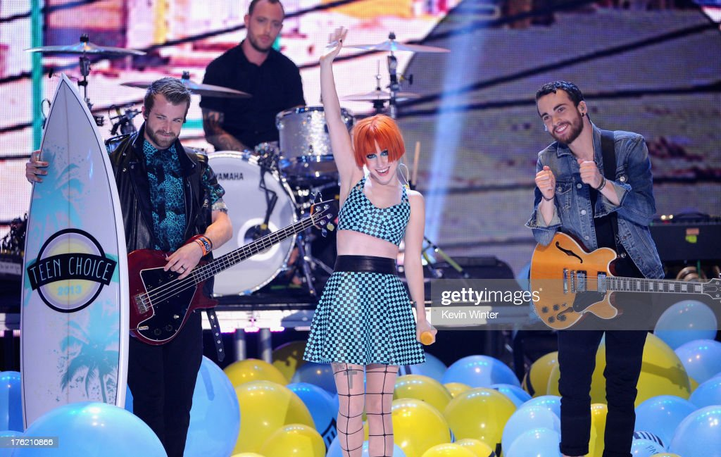 Musicians Jeremy Davis, <a gi-track='captionPersonalityLinkClicked' href=/galleries/search?phrase=Hayley+Williams&family=editorial&specificpeople=4383581 ng-click='$event.stopPropagation()'>Hayley Williams</a> and Taylor York of Paramore, winners of Choice Rock Group, speak onstage during the Teen Choice Awards 2013 at Gibson Amphitheatre on August 11, 2013 in Universal City, California.