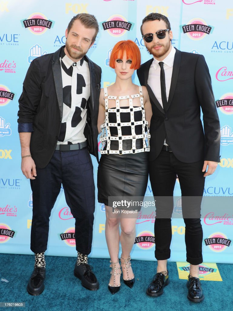 Musicians Jeremy Davis, Hayley Williams and Taylor York of Paramore arrive at the 2013 Teen Choice Awards at Gibson Amphitheatre on August 11, 2013 in Universal City, California.