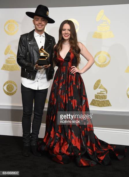 Musicians Jesse Joy pose with the Best Latin Pop Album Grammy for 'Un Besito Mas' in the press room during the 59th Annual Grammy music Awards on...