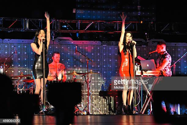 Musicians Jessica Origliaso and Lisa Origliasso of The Veronicas perform at The Forum on November 15 2014 in Inglewood California
