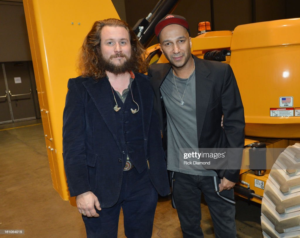 Musicians <a gi-track='captionPersonalityLinkClicked' href=/galleries/search?phrase=Jim+James&family=editorial&specificpeople=563700 ng-click='$event.stopPropagation()'>Jim James</a> and <a gi-track='captionPersonalityLinkClicked' href=/galleries/search?phrase=Tom+Morello&family=editorial&specificpeople=2133151 ng-click='$event.stopPropagation()'>Tom Morello</a> attend MusiCares Person Of The Year Honoring Bruce Springsteen at the Los Angeles Convention Center on February 8, 2013 in Los Angeles, California.