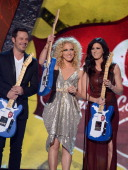 Musicians Jimi Westbrook Kimberly Roads Schlapman and Karen Fairchild of Little Big Town accept the award for Music Video of the Year Group onstage...