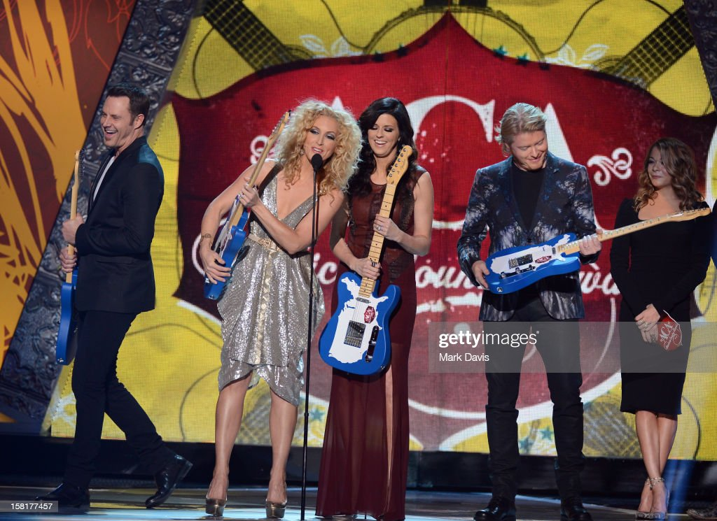 Musicians Jimi Westbrook, Kimberly Roads Schlapman, Karen Fairchild and Phillip Sweet of Little Big Town accept the award for Music Video of the Year: Group from presenter LeAnn Rimes onstage during the 2012 American Country Awards at the Mandalay Bay Events Center on December 10, 2012 in Las Vegas, Nevada.