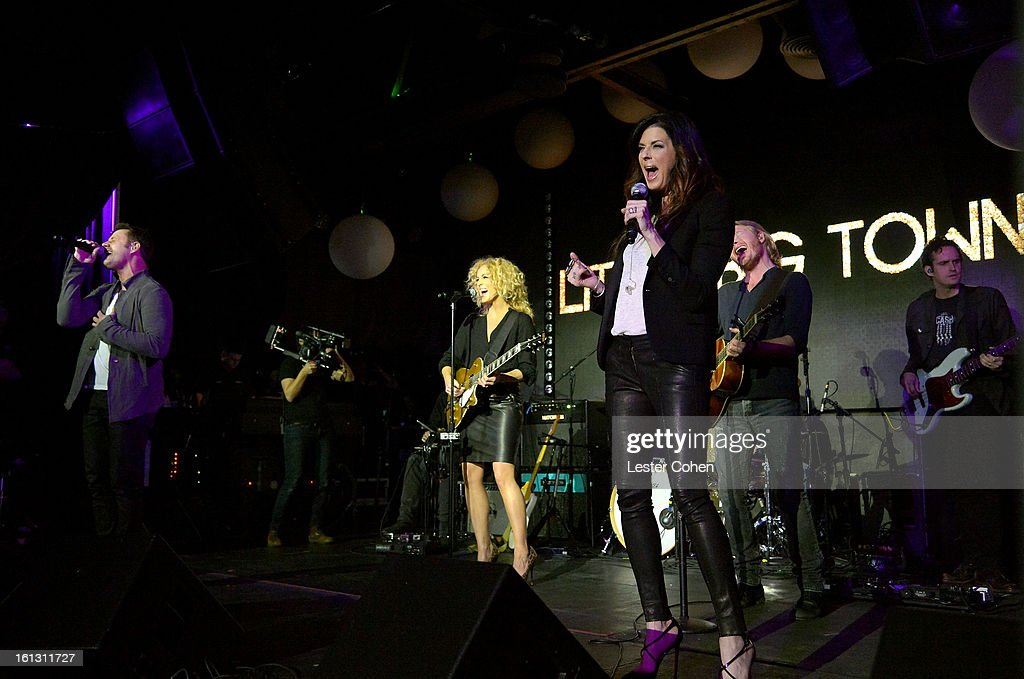 Musicians Jimi Westbrook, Kimberly Schlapman, Karen Fairchild, and Phillip Sweet of 'Little Big Town' perform onstage during Universal Music Group Showcase '13 at Lure on February 9, 2013 in Hollywood, California.