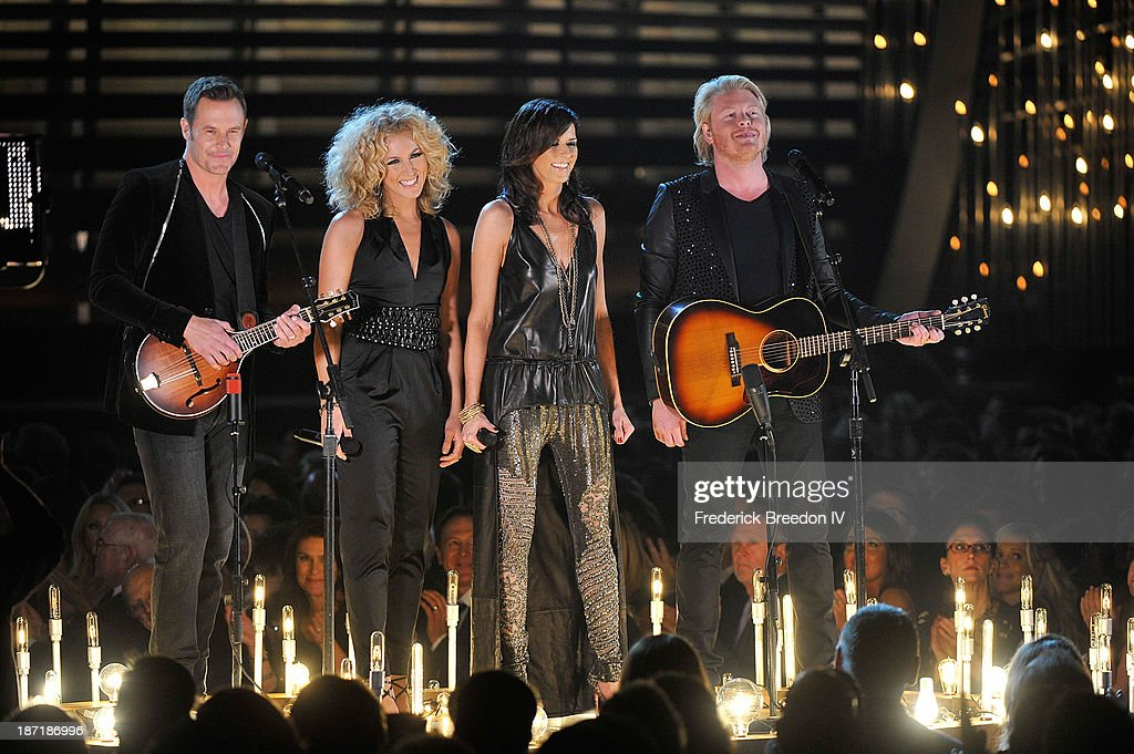 Musicians Jimi Westbrook, Kimberly Schlapman, Karen Fairchild and Philip Sweet of the band Little Big Town performs during the 47th annual CMA awards at the Bridgestone Arena on November 6, 2013 in Nashville, Tennessee.